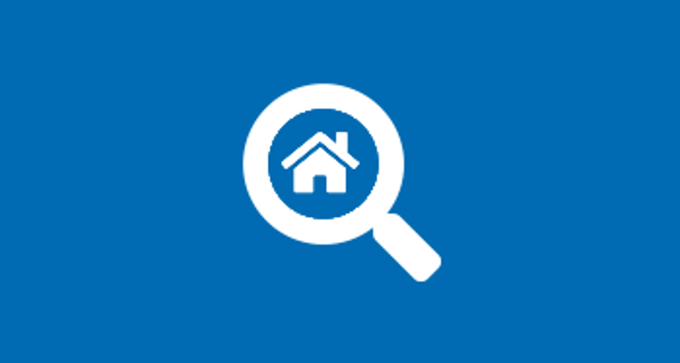 Magnifying glass icon with house